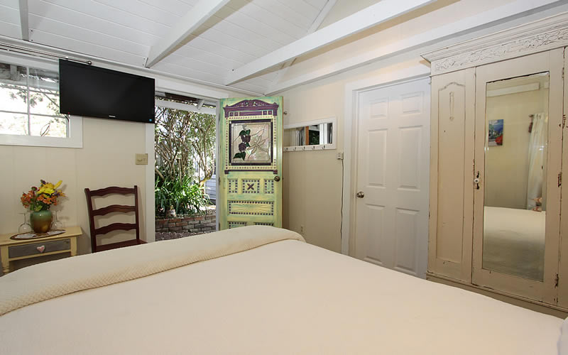 the shed guest room with bed and chairs plus television
