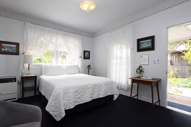 look out one guest room with bed and chair